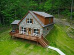 Beautiful riverfront cabin with modern interior and rustic/river exterior