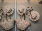 Sun hats, beach basket and Turkish towels to take to the pool