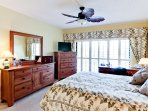 Master bedroom with beautiul white plantation shutters