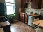Kitchen with dishwasher, stove, fridge/freezer, and microwave.