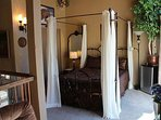 Queen-size canopy bed in the 'honeymoon suite' on second floor balcony  (with bedside refrigerator).