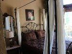The canopy bed with curtains open.
