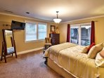 The master bedroom has a queen-sized bed.