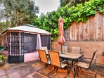 The backyard features a hot tub, outdoor seating, a BBQ grill and fireplace.
