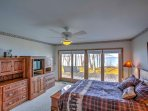 The master bedroom is on the first floor and offers views of the lake, a queen bed, cable TV, and Jacuzzi tub.