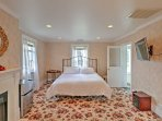 The master suite offers a king bed, gas fireplace, 43-inch flat-screen cable Smart TV, sitting room, and ensuite...