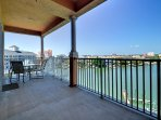A large balcony overlooking the water