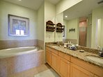 Large master bathroom with his and her sinks
