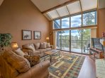 A high, vaulted ceiling, cabin-style decorations and natural light flooding from wall-to-wall windows above the balcony...