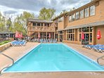 Spend your afternoon hours lounging poolside at this Bigfork vacation rental condo, available for an additional fee!