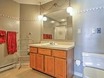This spacious bathroom offers a shower stall and a jetted tub. (This bathroom is being completely remodeled. New...