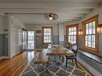 Vaulted ceilings and pristine hardwood floors welcome you as you enter into the home's formal dining room.