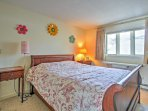 This bedroom features a comfortable queen-sized bed and built in desk area. This desk is great to do some necessary...
