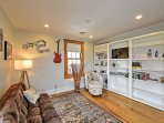 You'll also find an additional living area upstairs, which features a comfortable futon and a large bookshelf so that ...