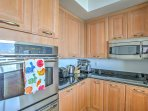 Prepare delectable dishes in the well-equipped kitchen.