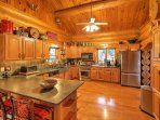 A spacious, open-layout and modern stainless steel appliances, including a gas-burning stovetop provide everything...