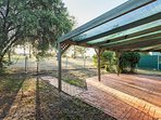 Outdoor area with BBQ, table and chairs. Direct access to park with play equipment,