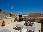 Sunbathing area and dining area on our Rooftop terrace