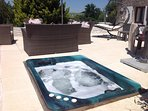 Spa tub set into terrace 3/4 person. This is not a toy for children. It is not heated.