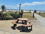 Picnic tables and grills cover this resort with great views of Gulf of Mexico just steps from pools