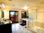 Master Bath with bathtub and shower/view of the lake.