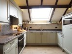 Fitted kitchen includes a microwave, electric cooker, fridge and dishwasher