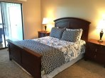 Queen bed in 2nd bedroom with views and access to the 3 seasons room and a view of the lake