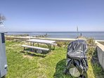 Fire up the grill and sear up some locally caught fish, then walk out to your private beach and spend your remaining...