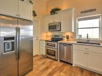 Cooking for 9 is effortless in this fully equipped kitchen.