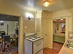 This kitchen features an oven and 4 burner stove top.