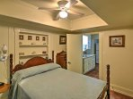 This bedroom features a full-sized bed with beautiful wooden dowels.