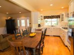 Open kitchen with large dining table
