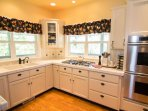 Kitchen with double ovens and gas cooktop for all your cooking needs