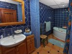 Pamper yourself in the Mediterranean blue bathroom en suite with surround music.