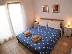 King sized bedroom with air con and a terrace with sea views
