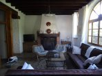 Lounge with TV, DVD Player, Google Chrome Cast and wood stove viewed from the terrace.