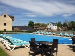 Enjoy a dip in the outdoor heated swimming pool
