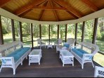 screened gazebo with extra outdoor seating