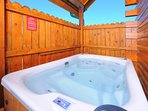 Soak in the private hot tub, letting the bubbles wash away your worries