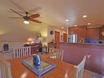 Open floor-plan with charming dining table and cute living room
