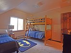Guest bedroom with a full bed and a bunk bed