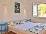 BEDROOM 1: sleeps 2 - Super King bed (180x200 cm) + closet + mosquito net on window