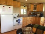 Full kitchen with stove, fridge and much more.