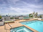 This spectacular rooftop deck features a pool, along with a grill and dining area.
