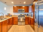 Whip up your favorite home-cooked meals in this fully equipped kitchen.