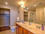 Freshen up in this pristine en suite bathroom.