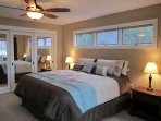 Lakeside bedroom with 46' TV and access to sunroom through French privacy doors