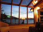 Lake and mountain view from the lakeside sun room with gas fireplace.