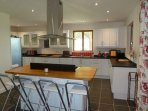 Kitchen, showing breakfast bar, which houses the range cooker.