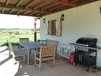 The outdoor dining area, with large gas barbeque and the lanterns, lovely lit in the evenings